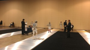 Care Bear during a bout (a fencing match). She's in the red socks.