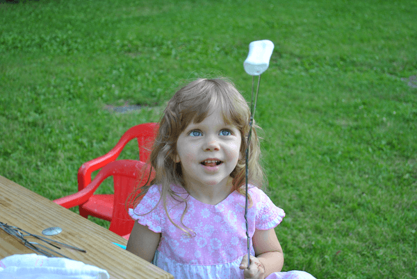 S'mores! The perfect preschooler activity while camping. See more on Free and Frugal Preschool Camping Activities! - www.MiddleWayMom.com
